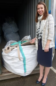 35  Louise Abbott, merchandise manager at Designer Contracts with unfitted carpet waste ready for recycling.